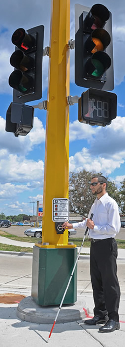 image of man next to accessible pedestrian signal